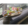 Vinilo Sticker bomb/Hellaflush en retrovisor